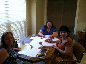 NEA Writers Club members Linda showing Carol and Donna how to draw