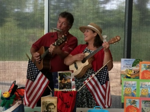 Rod Ragsdale and Carol Dabney play music for children's hour at the Hillary Clinton Children's Library and Learning Center