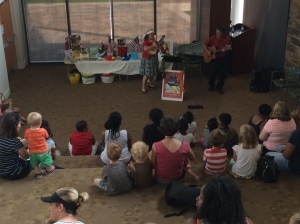 Children enjoy interactive music time with Carol Dabney and Rod Ragsdale June 30