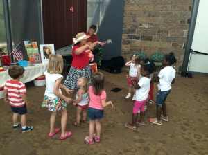 children singing and dancing with Miss Carol